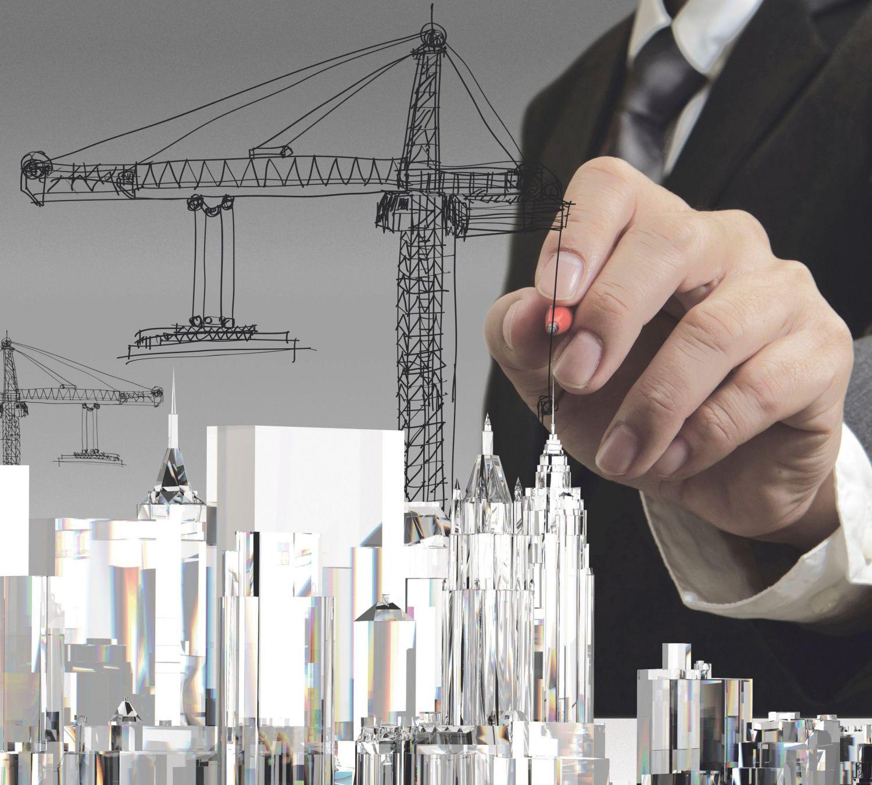 Übergroße Hand zeichnet die Wolkenkratzer einer Stadt. Thema: Verstädterung